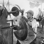 Woolenook, South Australia, 3 February 1944. A Japanese internee sharpening a saw blade at the mill at Woolenook Camp, one of the Loveday Internment Camp Group in the Barmera area. Photograph by Hedley Cullen. AWM 122974.