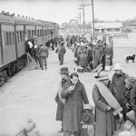 Renmark, South Australia, 13 May 1943.  Japanese internees starting to leave the train which brought them from Hay on their way to the Loveday Internment Camp Group in the Barmera area. Photograph by Hedley Cullen. AWM 123032.