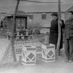 Loveday civil internment camp, camp 14 C. Dr. Morel visiting a shrine with Japanese camp leaders, July 1944. ICRC Archives: V-P-HIST-01877-25A.
